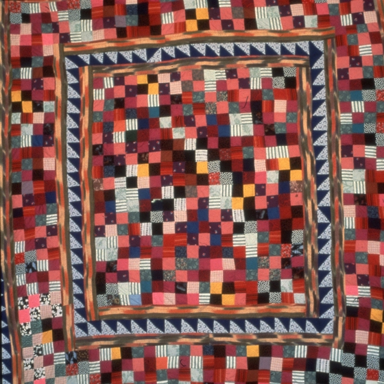"Nine patch and triangles quilt by Hystercine Rankin, 1987: ""I made this quilt for a woman who wanted to take something to France as a gift for the people she was living with that year. She wanted the gift to represent America."" Photograph by Patricia Crosby, courtesy Mississippi Cultural Crossroads and National Endowment for the Arts"