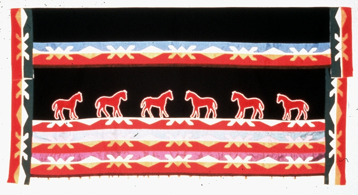 "Women's dance skirt by Georgeann Robinson, appliqué ribbon work on wool, 34"" x 65"", Bartlesville, Oklahoma, ca. 1970, Photograph by Michel Monteaux, Courtesy Museum of International Folk Art (a unit of the Museum of New Mexico)"