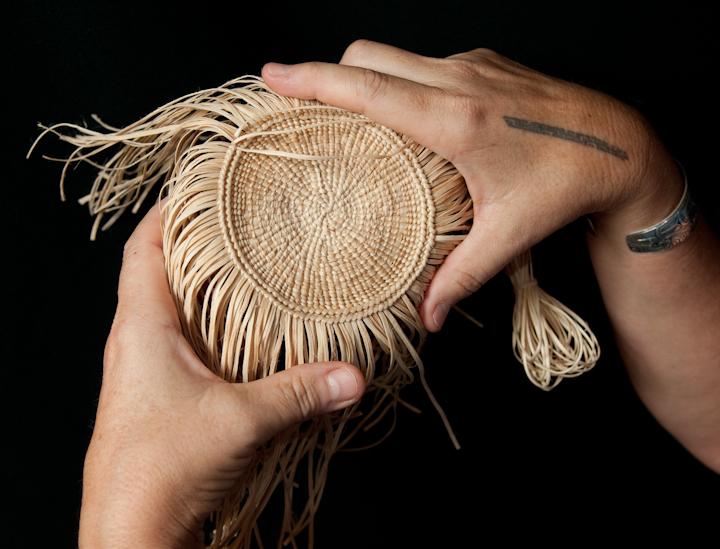 Teri Rofkar showing one of her baskets, Bethesda, Maryland, 2009, photograph by Alan Govenar