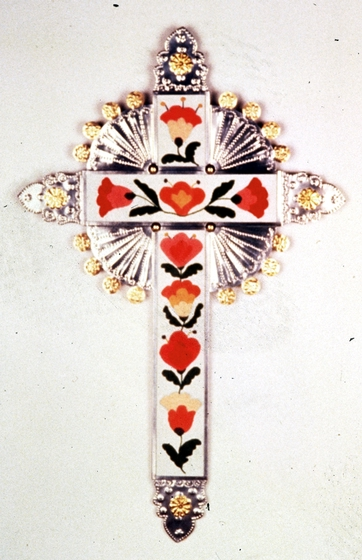 Tin cross by Emilio and Senaida Romero, tin with *colcha* embroidery, 34' high, Santa Fe, New Mexico, 1988, photograph by Michel Monteaux, courtesy Museum of International Folk Art (a unit of the Museum of New Mexico)