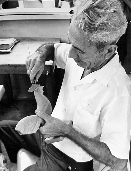 Emilio Rosado carving a rooster in his wood shop, Utuado, Puerto Rico, photograph by Walter Murray Chiesa, courtesy National Endowment for the Arts
