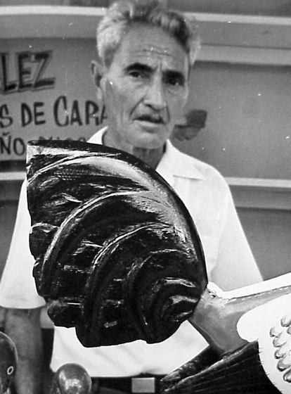 Emilio Rosado with one of his hand-carved roosters, courtesy National Endowment for the Arts