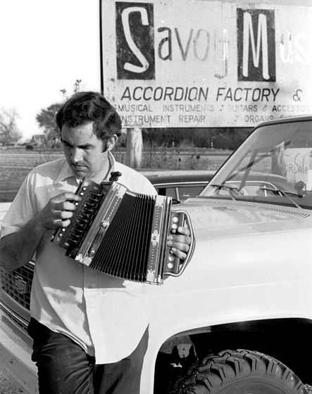 "Marc Savoy made his own button accordion from materials he found around his parents' farm near Eunice, Louisiana when he was 12 and learned to play it. Later, he repaired and restored accordions and gradually developed specific ideas of how to make the ""ideal"" accordion. Eunice, Louisiana, 1975, photograph by Nicholas R. Spitzer"