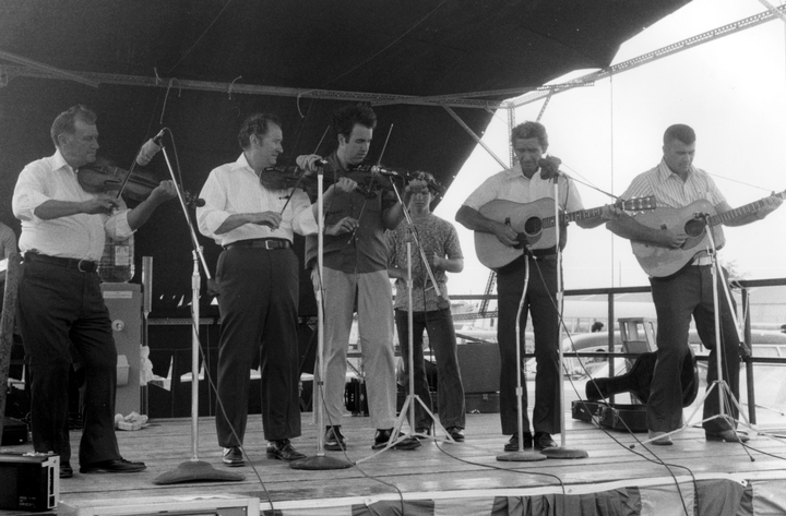 Marc Savoy performing with the Balfa brothers, New Orleans Jazz and Heritage Festival, 1974, Photograph by Chris Strachwitz/Arhoolie Records