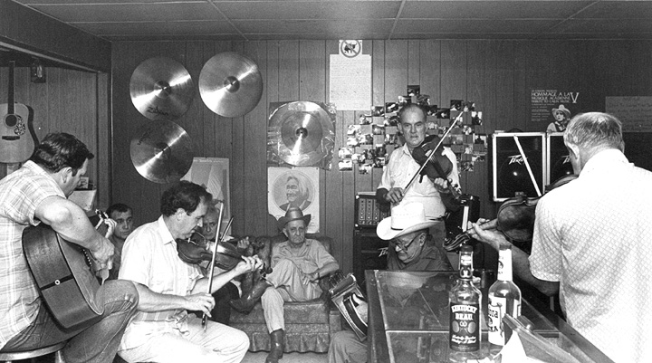 Cajun jam session at the Savoy Music Center with Marc Savoy (seated) on fiddle, Eunice, Louisiana, 1988, photograph by Jack Vartoogian