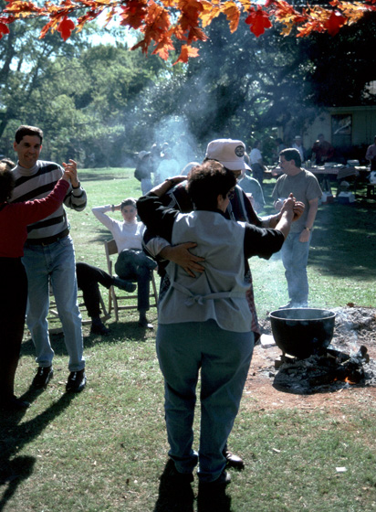 Dancing couples at the annual *boucherie* hosted by Marc and Ann Savoy, Eunice, Louisiana, 1996, photograph by Alan Govenar