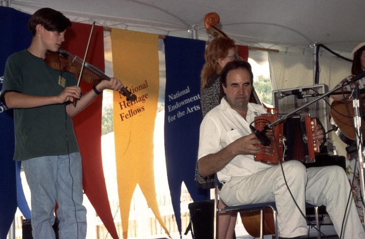 Marc Savoy (right) performing at the 1994 Festival of American Folklife in a program honoring the National Heritage Fellows, courtesy Ralph Rinzler Folklife Archives and Collections, Center for Folklife and Cultural Heritage, Smithsonian Institution
