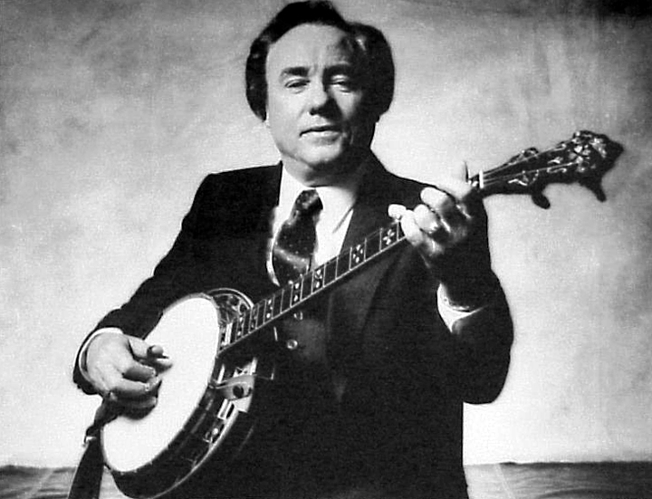 Earl Scruggs' fast three-finger picking played a major role in the emerging bluegrass sound when he played in Bill Monroe's band after World War II. After he left Monroe, he and guitarist Lester Flatt formed a successful team, but in 1969, he formed a new band, the Earl Scruggs Revue, featuring his sons, Gary, Randy and Steve. Photograph by Norman Seeff, courtesy National Endowment for the Arts