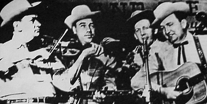 The Foggy Mountain Boys onstage at the *Grand Ole Opry* in the mid-1950s. Left to right: Paul Warren, Earl Scruggs, Curly Seckler and Lester Flatt, courtesy National Endowment for the Arts