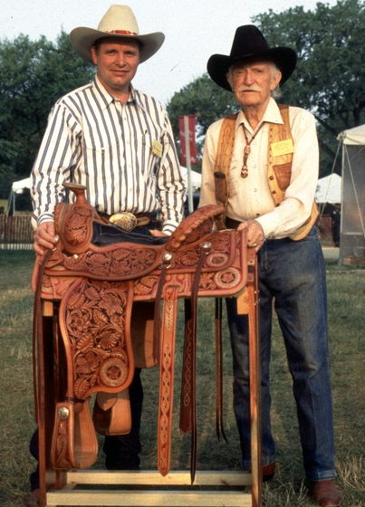Duff Severe and his  nephew Randy with one of his hand-crafted saddles, courtesy National Endowment for the Arts