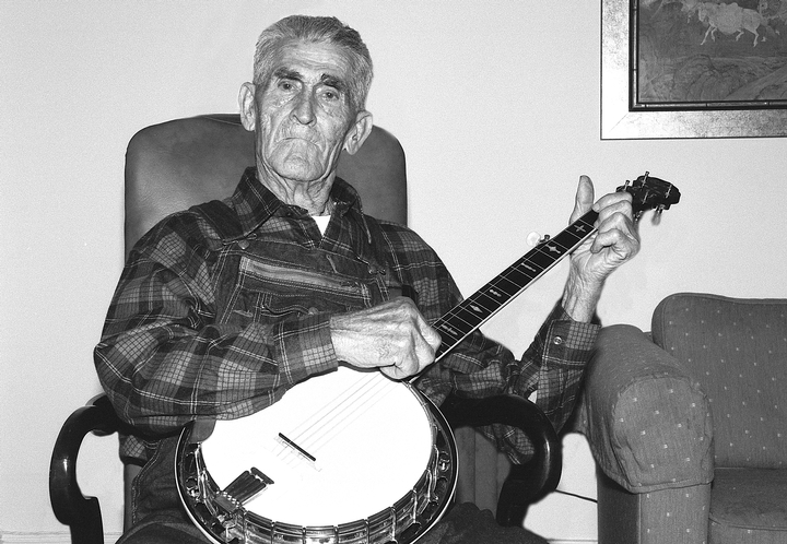 Morgan Sexton worked as a coal miner much of his life and enjoyed playing the banjo for family and friends, keeping active his repertoire of hundreds of traditional ballads, love songs and dance tunes. After his retirement, he began playing and singing in public. Washington, D.C., 1991, photograph by Alan Govenar