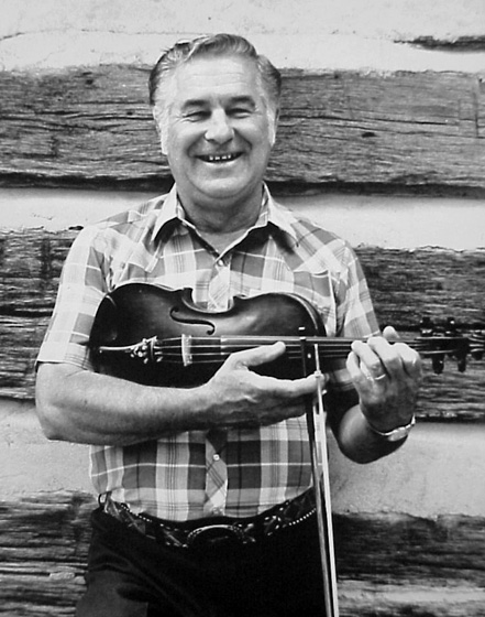 "Kenny Sidle is heir to a long tradition of Ohio fiddling. His music reflects a number of influences, including Texas and Canadian fiddling. Through the years he developed a distinctive ""contest"" style that is at once precise, melodic, smooth and sophisticated. Photograph by Phil Samuell, courtesy National Endowment for the Arts"