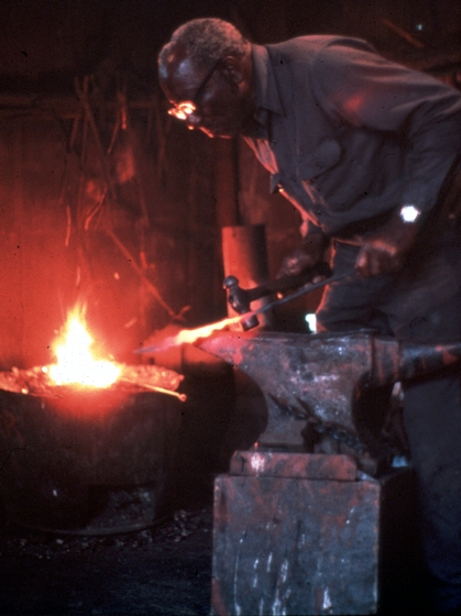 Philip Simmons at his forge, Charleston, South Carolina, 1980, photograph by John Vlach
