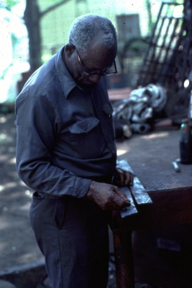 Philip Simmons designing leaves, Charleston, South Carolina, 1980, photograph by John Vlach