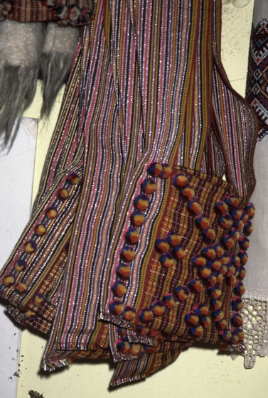 Woven sash and men's shoulder bags that are part of the traditional men's costume, courtesy New Jersey State Council on the Arts