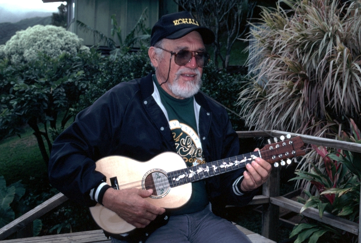 Clyde 'Kindy' Sproat on the deck of his home, Kapa'au, Hawaii, 1996, photograph by Alan Govenar