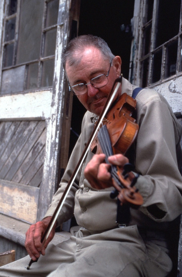 Playing country and old-time tunes on his fiddle is among Ralph W. Stanley's hobbies. Southwest Harbor, Maine, 1998, photograph by Peggy McKenna, courtesy National Endowment for the Arts
