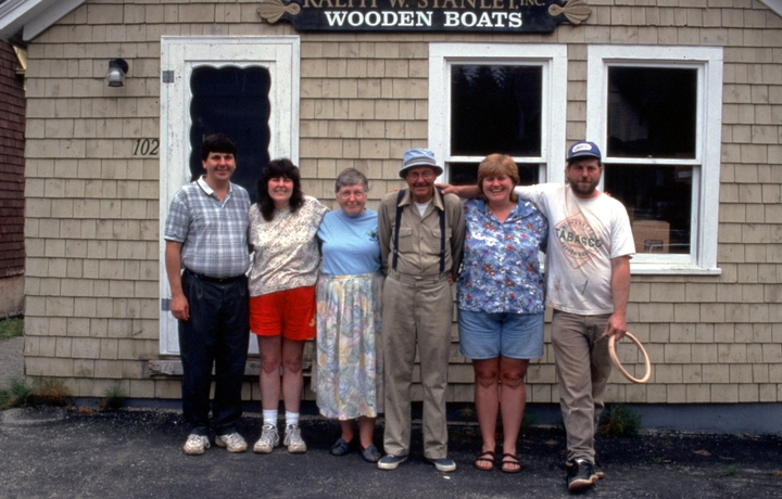 Ralph W. and Marion Stanley and their four children in front of the boat shop, Southwest Harbor, Maine, 1998, photograph by Peggy McKenna, Courtesy National Endowment for the Arts