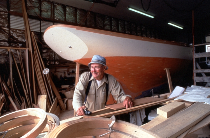 Ralph W. Stanley in his boat shop. Under construction behind him is the 29-foot Friendship sloop 'Acadia.' Southwest Harbor, Maine, 1998, photograph by Peggy McKenna, courtesy National Endowment for the Arts