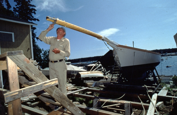 Ralph W. Stanley fastens a fitting onto the bowsprit of the Friendship sloop 'Acadia', Southwest Harbor, Maine, 1998, photograph by Peggy McKenna, courtesy National Endowment for the Arts