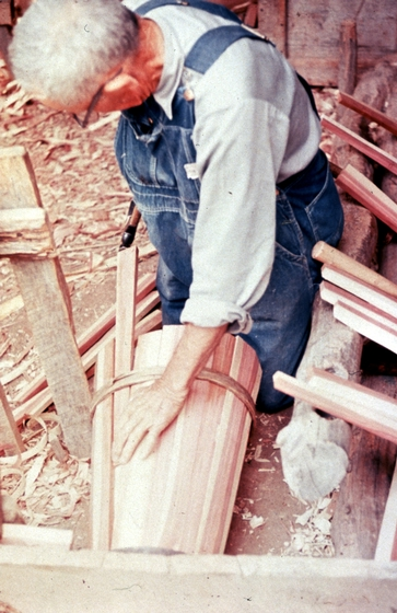 Alex Stewart at work in his shop, fitting the staves for a butter churn, Sneedville, Tennessee, ca. 1975-79, photograph by Roy Overcast, courtesy Tennessee Arts Commission