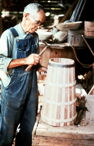 Alex Stewart at work in his shop, fitting the bottom of a butter churn, Sneedville, Tennessee, ca. 1975-79, photograph by Roy Overcast, courtesy Tennessee Arts Commission