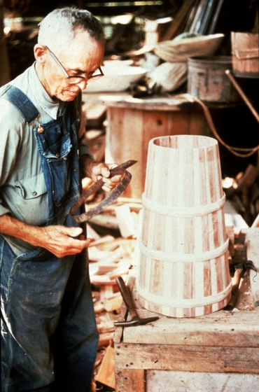 Alex Stewart at work in his shop, finishing a butter churn, Sneedville, Tennessee, ca. 1975-79, photograph by Roy Overcast, courtesy Tennessee Arts Commission