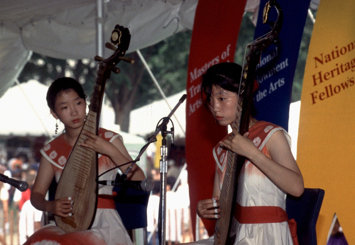 Juehua Tang and Jueli Tang performing at the 1994 Festival of American Folklife in a program honoring the National Heritage Fellows, courtesy Ralph Rinzler Folklife Archives and Collections, Center for Folklife and Cultural Heritage, Smithsonian Institution