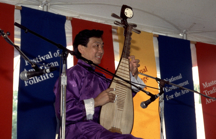 Liang-xing Tang performing at the 1994 Festival of American Folklife in a program honoring the National Heritage Fellows, courtesy Ralph Rinzler Folklife Archives and Collections, Center for Folklife and Cultural Heritage, Smithsonian Institution