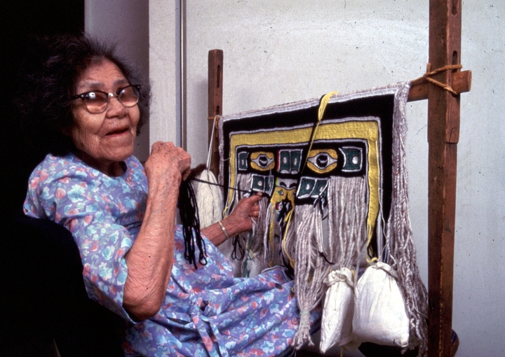 Jennie Thlunaut is credited with keeping alive the tradition of Tlingit Chilkat blanket weaving in Alaska during a time of declining interest in Native crafts. The designs woven into the blankets are the crests of family or clan groups. Klukwan, Alaska, 1985, courtesy National Endowment for the Arts