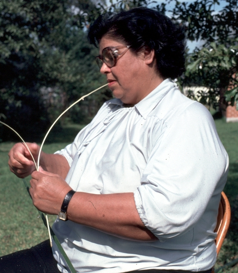 Ada Thomas, who grew up on a Chitimacha reservation in Louisiana, returned to making the tribe's traditional baskets in the mid-1970s. Making the double-woven baskets is a long, tedious process that begins with gathering cane and preparing it, as Thomas is doing in this photo. 1981, courtesy National Endowment for the Arts