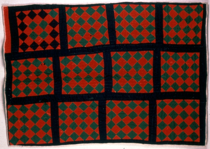Pieced strip quilt by Lucinda Toomer, photograph by Michel Monteaux, courtesy Museum of International Folk Art (a unit of the Museum of New Mexico)