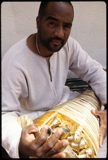 Ezequiel Torres and a *batá* drum, courtesy History Miami