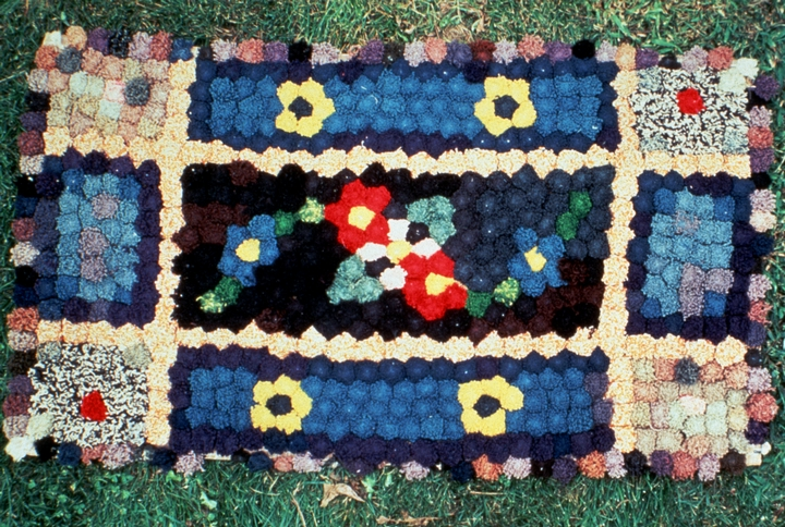 "'Pom Pom' rug by Dorothy Trumpold. ""To make this kind of rug, she unraveled old sweaters and other knitted pieces to form a 'pom pom' out of the curly yarn. Then she sewed the 'pom poms' to create a pattern on a piece of sturdy material. This rug Dorothy made when she was 10 years old.""  Comments and photograph courtesy Rosalie Ochs, Dorothy Trumpold's daughter"