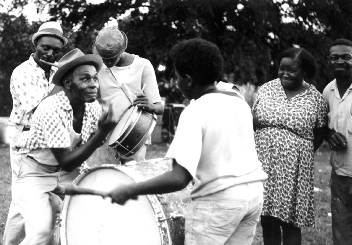Othar Turner dancing to fife and drum music, Senatobia, Mississippi, 1970, Photograph by David Evans