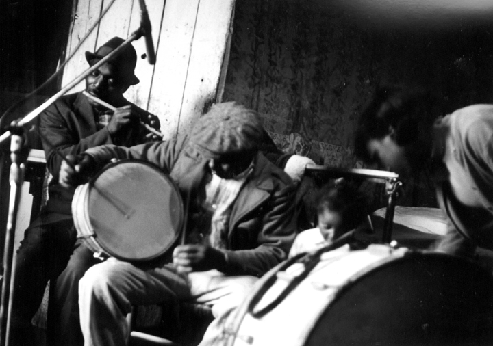 Othar Turner playing the snare drum, Senatobia, Mississippi, 1970, photograph by David Evans