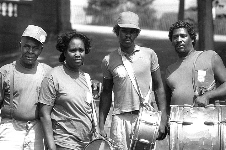 Othar Turner (far left) and his band, Chicago Blues Festival, Chicago, Illinois, 1991, photograph by Jack Vartoogian
