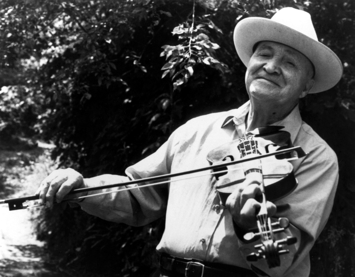 Doug Wallin sometimes accompanied himself on fiddle when he sang but still preferred the traditional unaccompanied ballad form he learned while growing up in the Blue Ridge Mountains. His songs are among the most direct reflections of the cultural heritage of the early white settlers of the Appalachian region. Photograph by Jeffrey Smith, courtesy National Endowment for the Arts