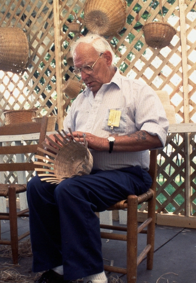 Newton Washburn broke family tradition by showing outsiders how to make the brown ash split baskets that his ancestors, the Sweetsers, began making as early as 1850. Here, he works on a basket in his shop in Bethlehem, New Hampshire. August 1987, photograph by Jane C. Beck, courtesy Vermont Folklife Center