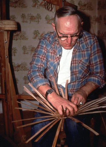 Newton Washburn setting up the bottom of a brown ash basket, Bethlehem, New Hampshire, January 1987, photograph by Jane C. Beck, courtesy Vermont Folklife Center