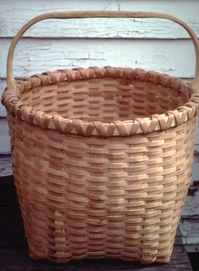 Brown ash basket by Newton Washburn,  Bethlehem, New Hampshire, August 1987, photograph by Jane C. Beck, courtesy Vermont Folklife Center