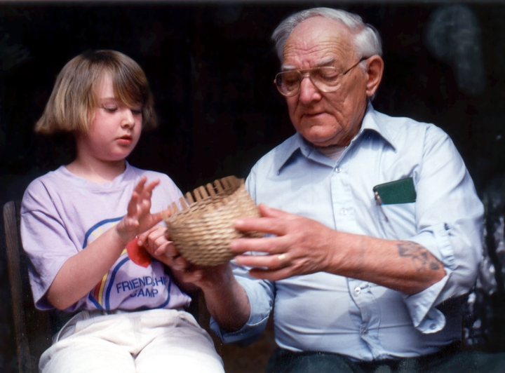 Leah Washburn gets instruction from her grandfather, Newton Washburn, as she learns to make a brown ash basket, Bethlehem, New Hampshire, August 1987, photograph by Jane C. Beck, courtesy Vermont Folklife Center