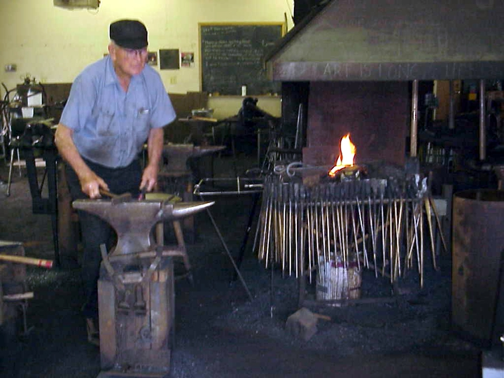 Francis Whitaker in his blacksmith shop, Carbondale, Colorado, 1998, photograph by Alan Govenar