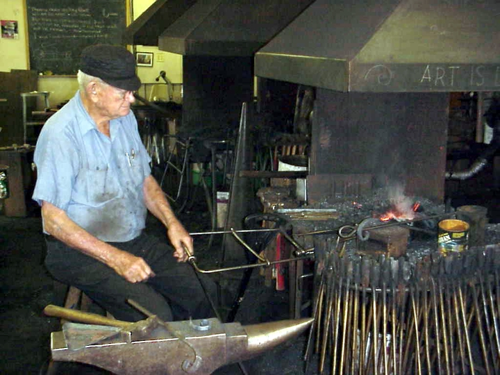 Francis Whitaker at work in his blacksmith shop, Carbondale, Colorado, 1998, photograph by Alan Govenar