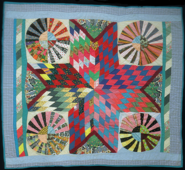 "'Star and Wheel,' pieced by Arbie Wiliams using leftovers and found patchwork, quilted by Irene Bankhead, Oakland, California, 1988, 66""x76"", courtesy Eli Leon"
