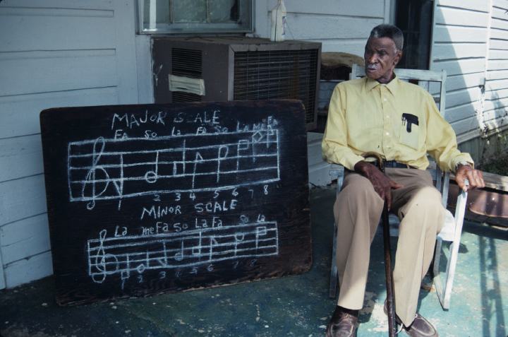 Shape-note singer Dewey Williams lived in southeast Alabama, one of the only areas of the country with a vibrant black Sacred Harp tradition. The music takes its name from a songbook first published in 1844. Ozark, Alabama, 1991, photograph by Alan Govenar