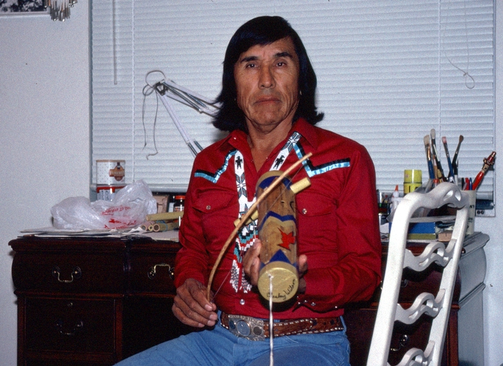 "Apache violin maker Chesley Goseyun Wilson describes the sound of the one-string instrument as a cross between that of a soft flute and a dulcimer. ""My fiddle only plays Apache songs."" Tucson, Arizona, 1991, photograph by Alan Govenar"