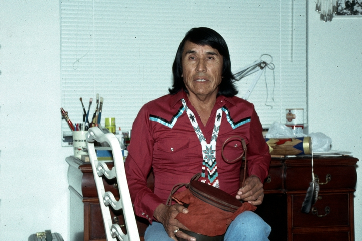 Chesley Goseyun Wilson playing his Apache drum, Tucson, Arizona, 1991, photograph by Alan Govenar