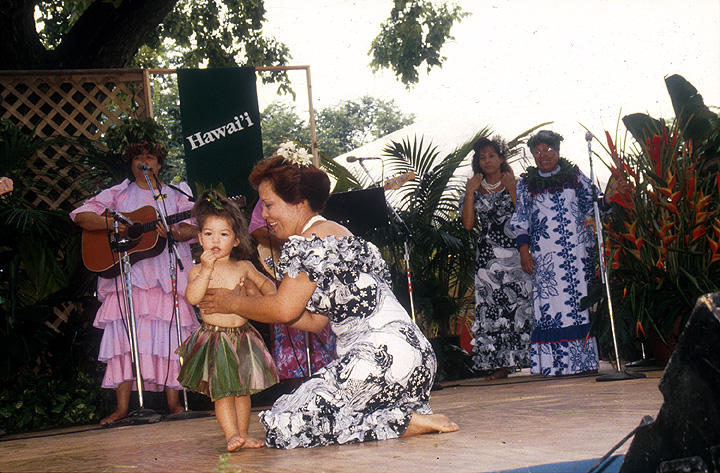 The Zuttermeister Family — Hawaiian Hula Dance. Chanter: Emily Kaui'i Zuttermeister, *kumu hula*. Dancers: Noenoelani Zuttermeister Lewis, Emily's daughter, and Hauolionani Zuttermeister, Emily's granddaughter. 1989, photograph by Jeff Tinsley, courtesy Ralph Rinzler Folklife Archives and Collections, Center for Folklife and Cultural Heritage, Smithsonian Institution