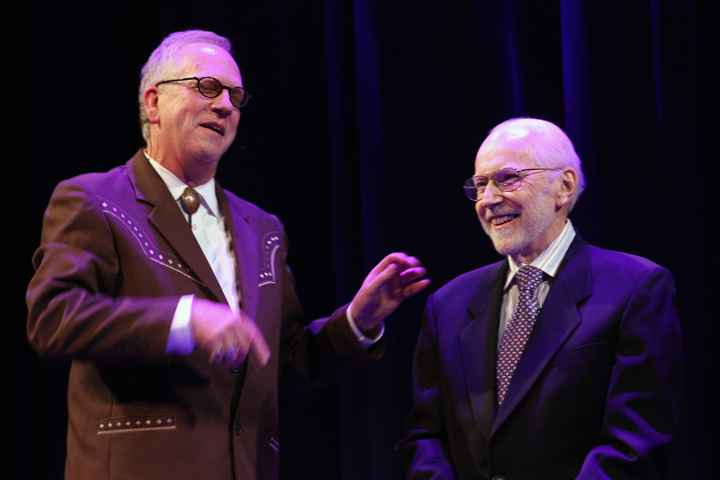Nicholas R. Spitzer interviewing Mike Auldridge at the 2012 National Heritage Fellowship Concert, Washington, D.C., photograph by Michael G. Stewart